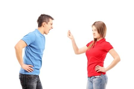 18348472 - young man and woman having an argument isolated on white background